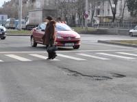 Bulevardul Henri Coandă, unul dintre cele mai scumpe drumuri din țară, plin de gropi
