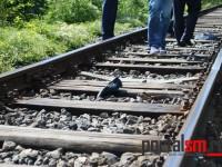 Barbat lovit de tren