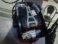 Țigări de contrabandă, ascunse într-un scaun pentru copii